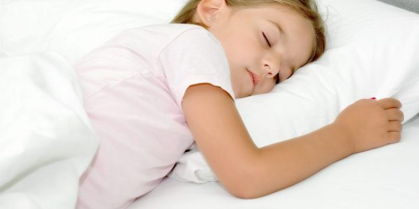 Adorable,Little,Girl,Sleeping,In,A,Bed
