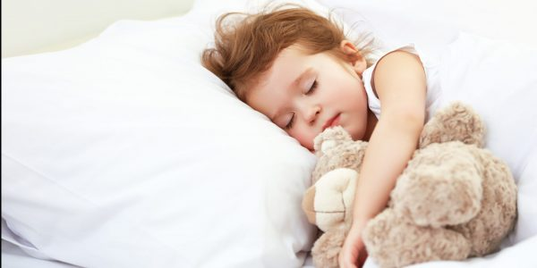 Child,Little,Girl,Sleeps,In,The,Bed,With,A,Toy