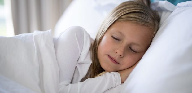 Girl,Sleeping,On,Bed,In,Bedroom,At,Home